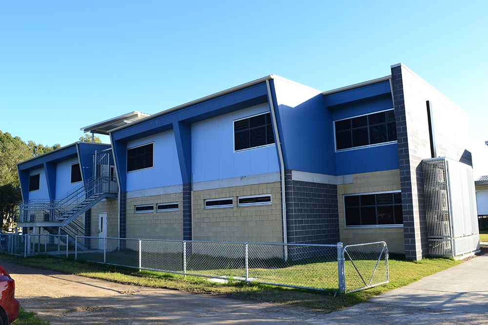 New two level education building with large windows at Belmont State School.